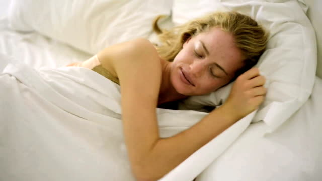 Blond woman in bed video