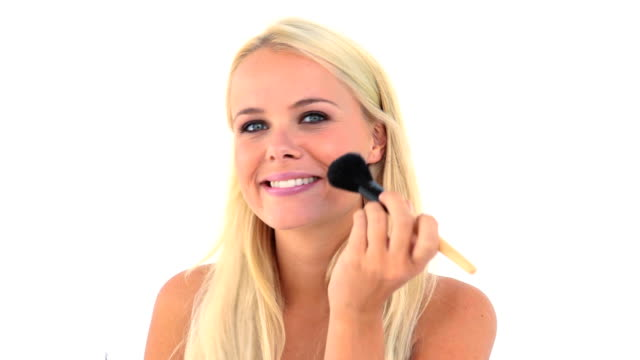 Blonde applying powder on her face video