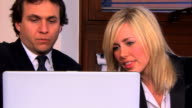 Blonde businesswoman and colleague video