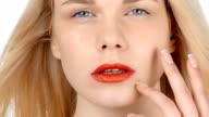 Blonde girl posing, flirting on a white background video