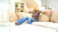 Blonde Girl Relaxing on Home Sofa video