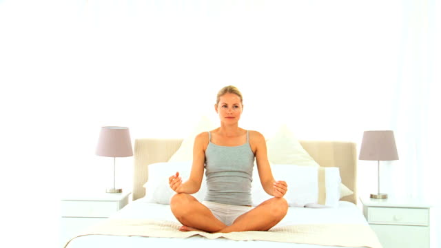 Blonde woman doing the lotus position video