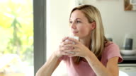 Blonde woman enjoying her drink video