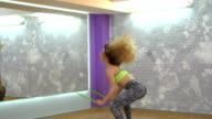 Blonde woman in gym video