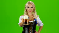 Blonde woman in traditional bavarian costume. Green screen video