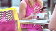 Blonde woman using her phone while sitting with her friend video