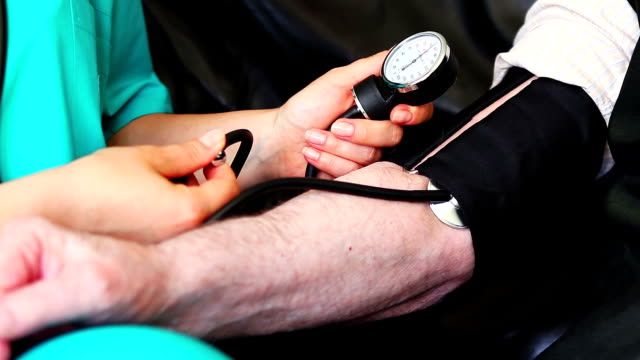 Blood pressure check to a senior close up video