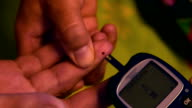 Blood sugar level test with glucometer video
