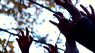 Bloodthirsty creatures stretching hands to catch victim, zombie attack in video
