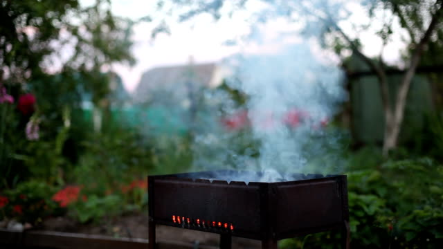 Blow up fire on barbecue video