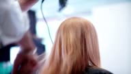 Blow-dry hair. Male hand hairdresser makes hair styling by hairdryer video