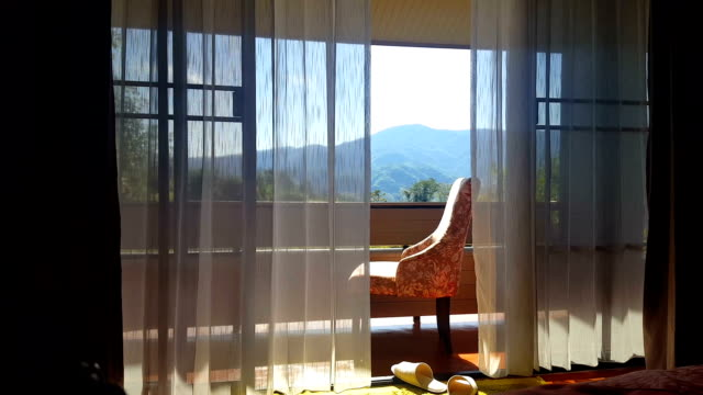 Blowing curtain with armchair. video