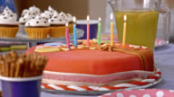 Blowing out the candles on a birthday cake video