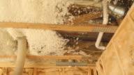 Blown Insulation Installing Between House Floor Joists video