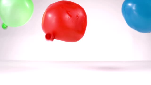 Blue and green and red water balloon falling video