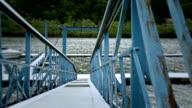 Blue bridge to a pier on river video