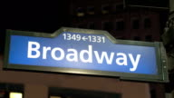 CLOSE UP: Blue Broadway road sign with numbers at street corner in New York video