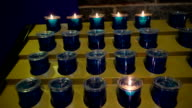 Blue candles on the candle holders inside the abbey in Ireland video
