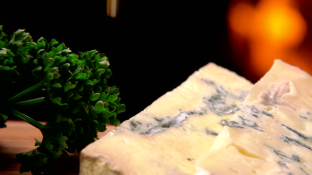 Blue cheese is poured with honey video