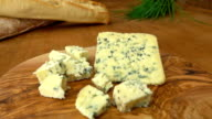 Blue cheese Roquefort on the board with baguette video