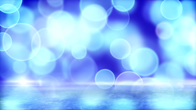 blue circle bokeh lights and reflection on ice loop video