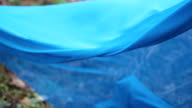 Blue fabric in forest video