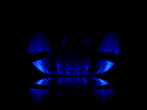 Blue Gas Flame with reflection on black backround. video