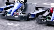 HD: Blue go-carts parked at starting line on racing track video