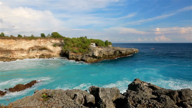 Blue lagoon with transparent water surrounded by the cliff. Nusa Lembongan, Bali, Indonesia. video