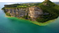 Blue lake garda with big cliff aerial view video