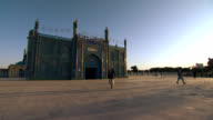 Blue Mosque in Afghanistan with people walking. video