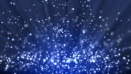 Blue particle background and light rays video