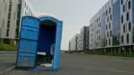 Blue public toilet at empty street of innopolis city, close up video