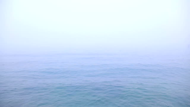 Blue sea background in the fog video