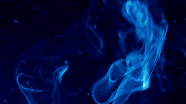 Blue sparks and flowing smoke. Magic Burst with fairy dust video