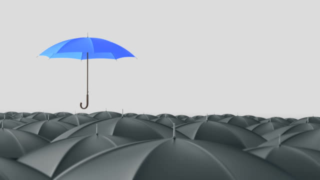 Blue umbrella standing out from crowd mass concept video
