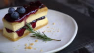 blueberry cheese cake on white plate video