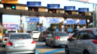 Blur Cars arrive at a toll plaza on the highway video
