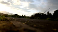 blur people riding bike outdoors in park at sunset, fitness, sport and exercise, healthy life and lifestyle concept. video