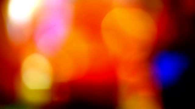 blurred beautiful red glare light background flickering movement for your text video