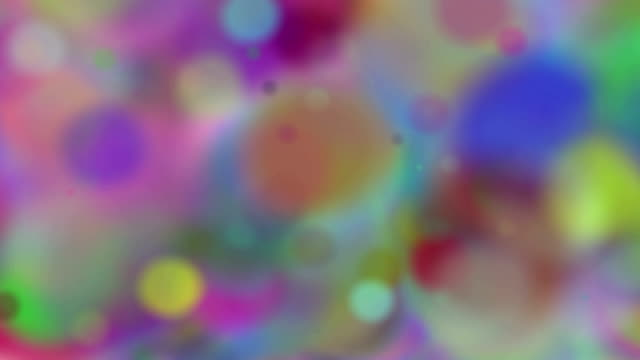 Blurred bokeh. Multicolored bokeh from circles. Animated colored particles. video