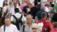 Blurred Crowd Crossing Maremagnum Bridge in Barcelona video