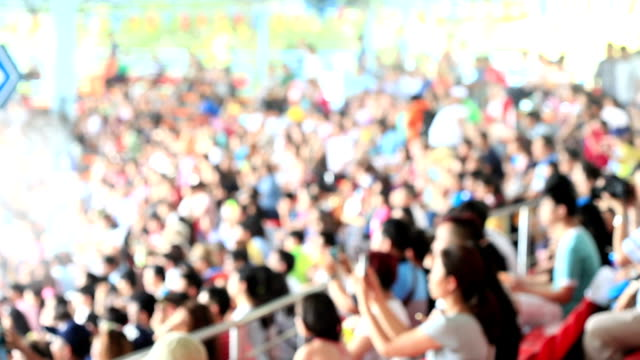 Blurred crowd of spectators on a stadium tribune video