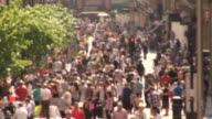 Blurred crowded street with people - HD & PAL video