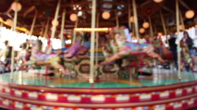 Blurred fairground carousel ride video