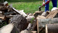 blurred farmer man chop wood with axe. FullHD video