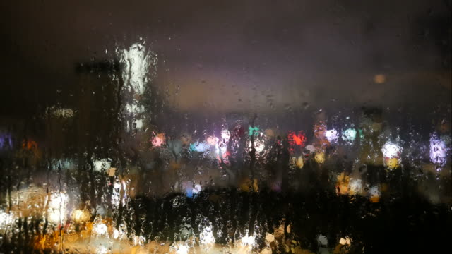 Blurred modern cityscape and night background from window video
