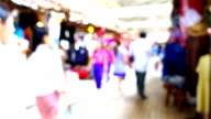 Blurred motion of crowd of people walking in shopping mall video