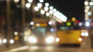 Blurred night traffic scene with buses in Barcelona. video