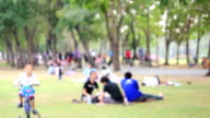 HD: Blurred people enjoy in republic park at evening video